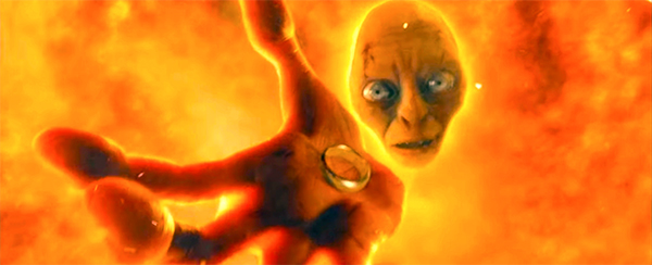 Gollum holds the ring above the magma.